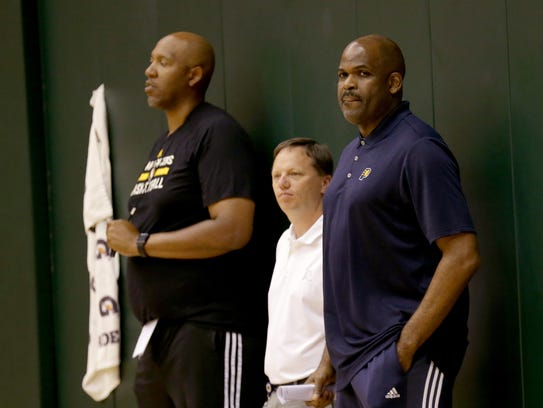 Indiana Pacers head coach Nate McMillan,right, watches