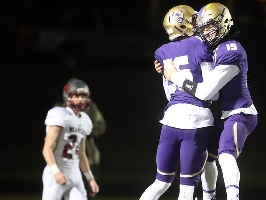 North Kitsap receiver Kai Warren (middle) and quarterback Andrew Blackmore (right) celebrate a second-half touchdown pass Friday against W.F. West.