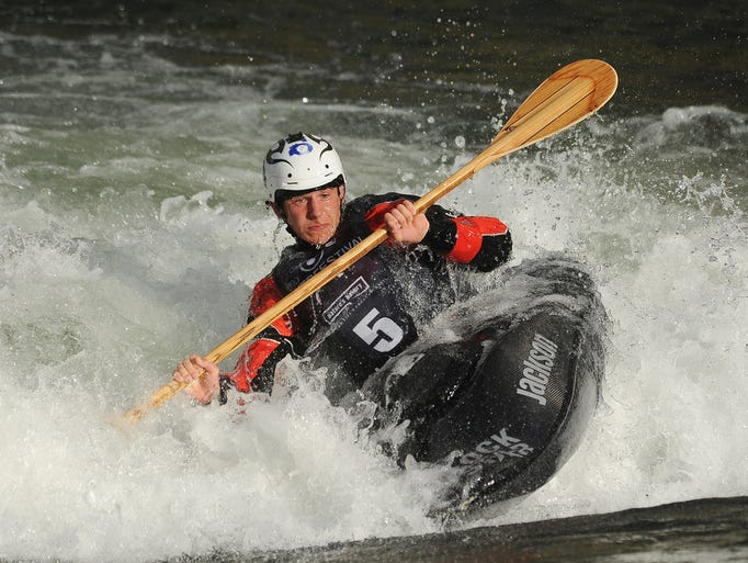 Reno's Jason Craig competes in the freestyle kayak finals during the 11th annual Reno River Festival on Saturday. Craig won the men's competition, scoring 1380 points on his first of three runs in the finals.