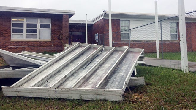 A Thursday, March 31, 2016, storm tore awning from some classrooms at Purvis Upper Elementary School in Purvis Miss., as a severe thunderstorm passed through the area. Authorities have yet to determine whether it was a tornado. No children or faculty were injured in the incident and the school day resumed as normal.