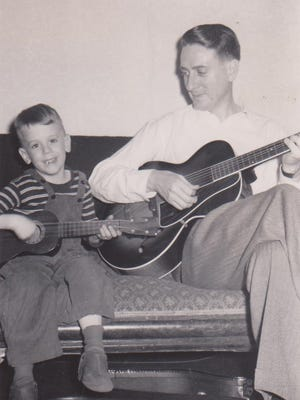 Richard Stutzman plays with his father, Eldon Stutzman, in this circa 1950 photo.