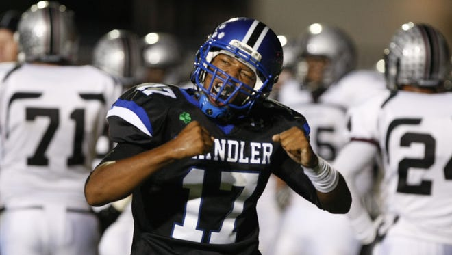 Chandler High quarterback Brett Hundley celebrates after scoring a touchdown against Hamilton High during the 2010 season.