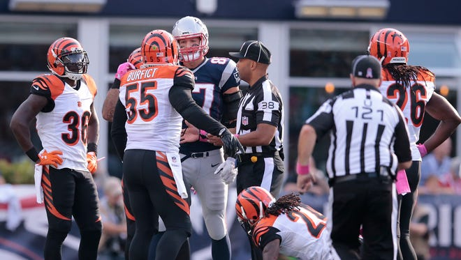 Patriots tight end Rob Gronkowski and Bengals linebacker Vontaze Burfict exchange words in the fourth quarter of Sunday's 35-17 loss by the Bengals.