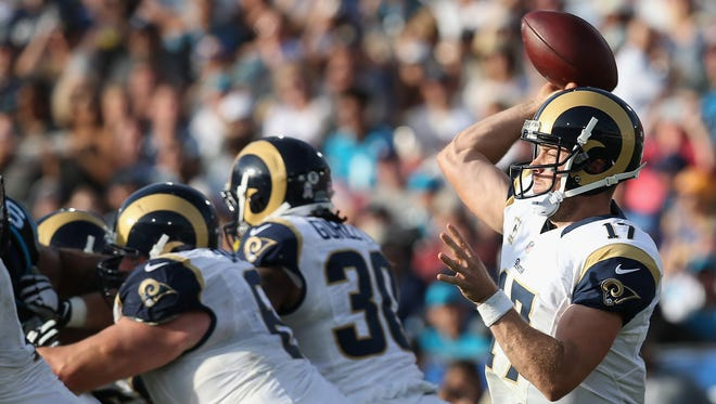 Case Keenum #17 of the Los Angeles Rams throws the ball from the pocket during the third quarter of the game against the Los Angeles Rams at the Los Angeles Coliseum on November 6, 2016 in Los Angeles, California.