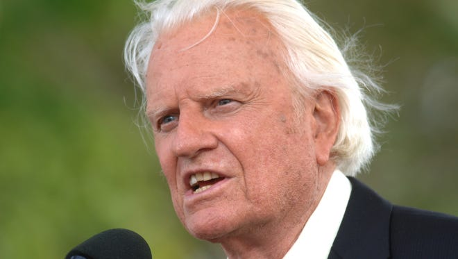 In this June 26, 2005 file photo, the Rev. Billy Graham speaks on stage on the third and last day of his farewell American revival in the Queens borough of New York.  A spokesman said on Graham has died at his home in North Carolina at age 99. (AP Photo/Henny Ray Abrams)