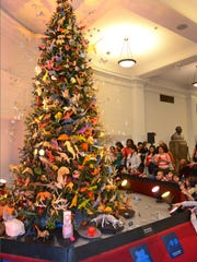The origami tree draws visitors to the American Museum