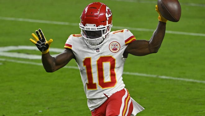 Kansas City Chiefs wide receiver Tyreek Hill (10) runs into the end zone for a touchdown against the Las Vegas Raiders during the first half of an NFL football game, Sunday, Nov. 22, 2020, in Las Vegas.