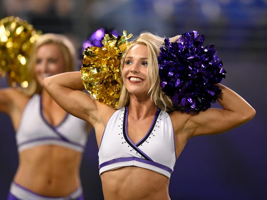 A Baltimore Ravens cheerleader performs in the second