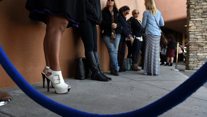 Lynette Fernandes and her stylish shoes line up with fellow shoppers to take advantage of the opening of a new Nordstrom Rack store in Reno on Thursday, March 26, 2015.