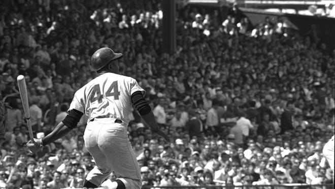 Hank Aaron of the Atlanta Braves follows through after getting the 3,000th hit of his major league career in the first inning of the second game with Cincinnati on Sunday, May 17, 1970. Aaron, who was hitless in the first game, hit a homer in his second at-bat in the nightcap.