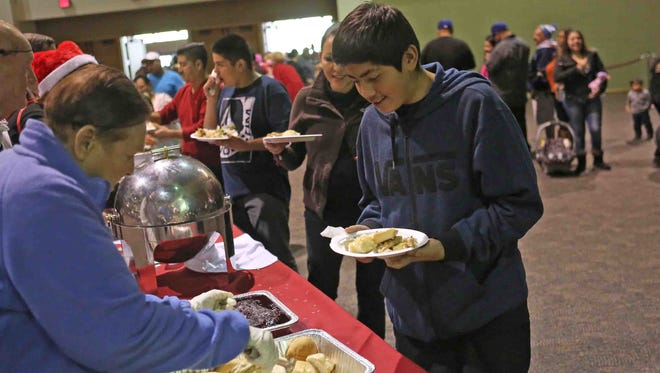 Hundreds of people were served a holiday meal on Christmas Day 2014 at the Palm Springs Convention Center . Well in the Desert was one of the presenters of the event.