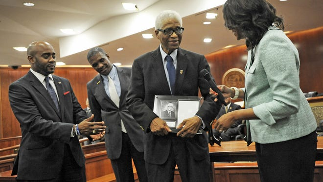Dr. Robert B. Hayling receives a plaque after being inducted into the Florida Civil Rights Hall of Fame in 2014.  Hayling was inducted along with James Weldon Johnson and Asa Philip Randolph.