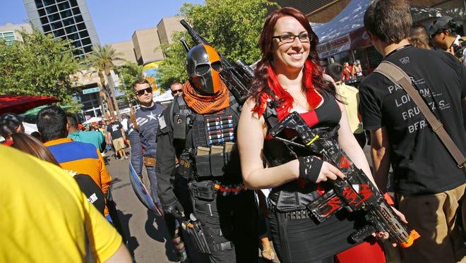 People in costume walk through downtown on their way to Phoenix Comicon Saturday, June 4, 2016 in Phoenix, Ariz.