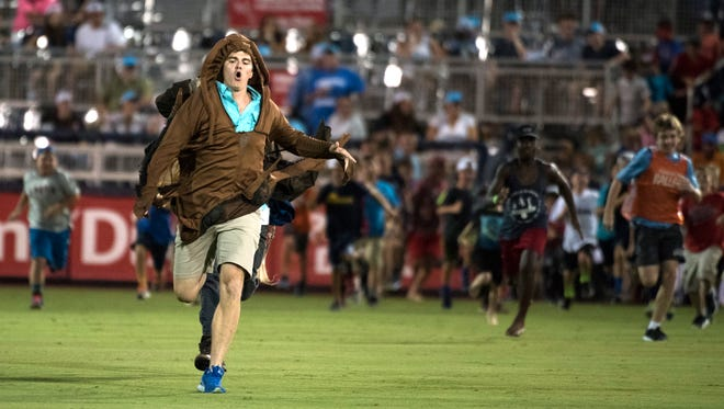 Pensacola News Journal Sports Reporter Eric Wallace donned the insect costume for the 4th-inning Roach Run during a Blue Wahoos game last July. The Roach Run is just one of many things that makes catching a game this summer worthwhile.