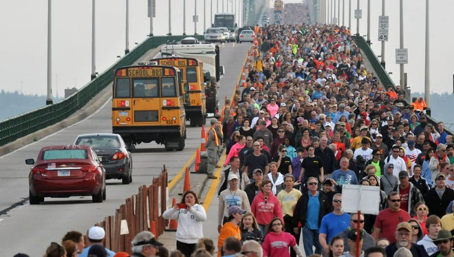Walkers cross the five-mile-long Mackinac Bridge during the Labor Day walk, Monday, Sept. 1, 2014, during the 57th annual event in Mackinaw City, Mich. Lead by Michigan Gov. Rick Snyder, thousands cross from the upper peninsula of Michigan to the lower peninsula, the only day pedestrians are allowed on the span.
