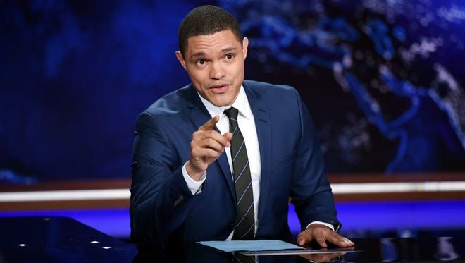 """Trevor Noah works on the set of """"The Daily Show with Trevor Noah"""" on Sept. 29, 2015 in New York. Comedy Central is among Viacom channels that could go dark for Charter Communications subscribers if the pay-TV provider and media company do not come to a carriage agreement."""