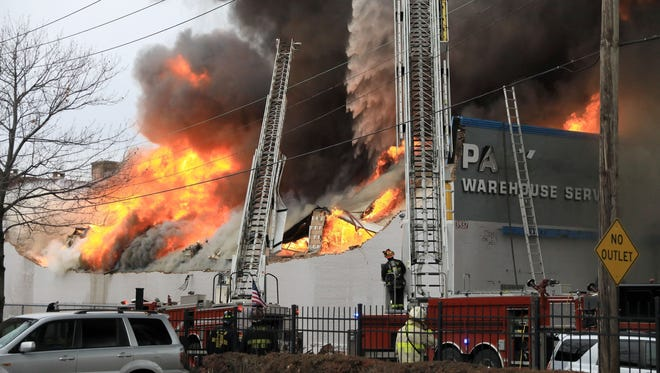 St. Louis firefighters battle a warehouse fire in the 3900 block of Park Avenue in St. Louis on Wednesday, Nov. 15, 2017.  (David Carson/St. Louis Post-Dispatch via AP)