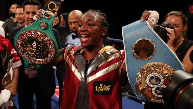 Claressa Shields celebrates winning her IBF and WBA world middleweight championship fight against Hanna Gabriels.