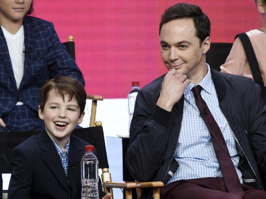 """Iain Armitage, left, a cast member in the CBS series """"Young Sheldon,"""" answers a question as executive producer/narrator Jim Parsons looks on during a panel discussion at the Television Critics Association Summer Press Tour in Beverly Hills, Calif. CBS has earned the distinction of television's most-watched network for the 12th season in a row, and for the 17th time in the last 18 years."""