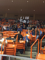 "A group of UTEP fans hold up a ""Fire Floyd"" sign earlier"