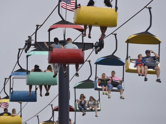 Fairgoers take the opportunity to take some stress off their feet and see the Minnesota State Fair from above Thursday, Aug. 25, 2016 during the opening day.