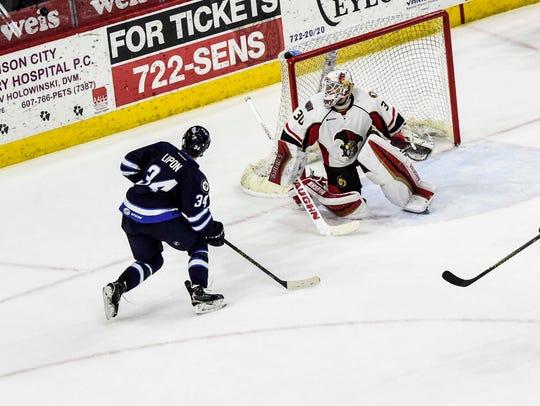 Binghamton goalie Andrew Hammond makes a save on St.