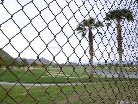 In answer to a state and federal mandate, the city of La Quinta installed a fence at SilverRock in 2017 to keep Peninsular bighorn sheep from grazing on the golf course.