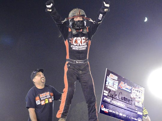 Kyle Cummins stood on the car after winning the feature at Kokomo Speedway during Indiana Sprint Week.