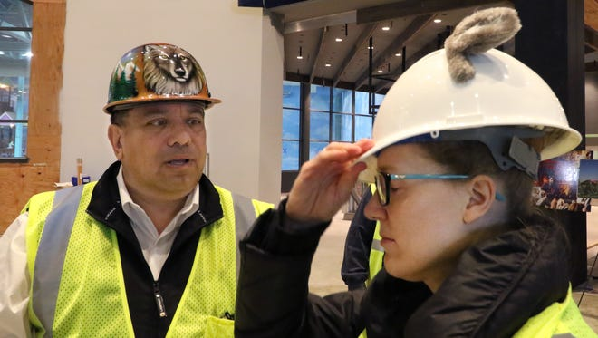 Reporter Amy Schwabe dons a hard hat for a tour of the Great Wolf Lodge in Gurnee, Illinois, with General Manager Emilio Fabico.