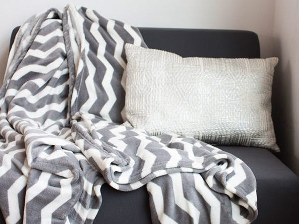 Members can grab this king-sized chevron blanket for only $49.
