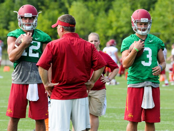 Iowa State Football practice was open to the media to get a look at the team for this fall. Quarterback Coach, Todd Sturdy, talks to his players during practice. (12) Sam Richardson and (3) Grant Rohach run the drill.