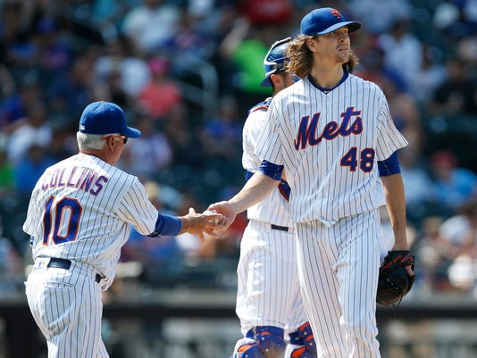 New York Mets pitcher Jacob deGrom (48) hands the ball to manager Terry Collins (10) after giving up a 3-run home run to Miami Marlins' Giancarlo Stanton during the seventh inning of a baseball game, Sunday, Aug. 20, 2017, in New York. (AP Photo/Rich Schultz)