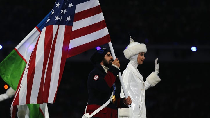 Flagbearer and Ice Sledge Hockey player Steve Cash of the United States enters the stadium during the Sochi 2014 Paralympic Winter Games Closing Ceremony at Fisht Olympic Stadium on Sunday.