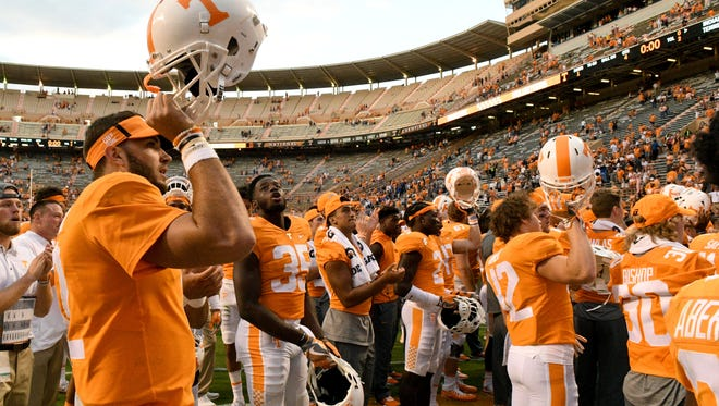 Vols quarterback Quinten Dormady and teammates sing along to the Tennessee Waltz after a 42-7 win over Indiana State on  Saturday, Sept. 9, 2017, at Neyland Stadium.