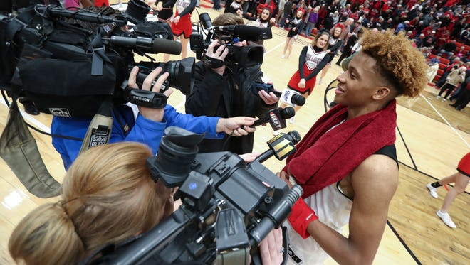 New Albany's Romeo Langford (1) was interviewed by the media after their win over Bedford North Lawrence at New Albany High School.  It is Langford's last home game.  