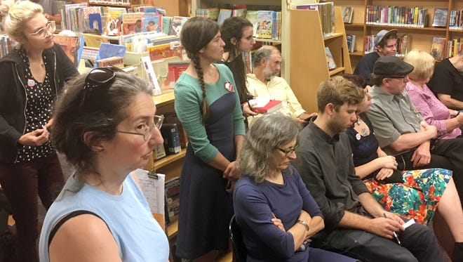 Activists against a potential sale of the North Building of the Public Library of Cincinnati and Hamilton County's Downtown space filled the board meeting in Mount Healthy Tuesday.