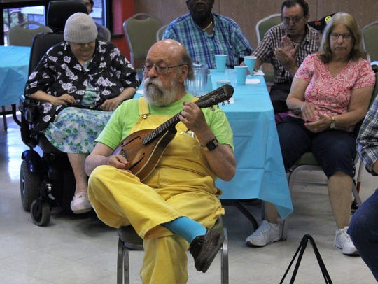 Paul Prestopino plays at the bluegrass jam and ice cream social at the Highland Park boro Senior Center on July 10; he has played with John Denver and with Peter, Paul and Mary.