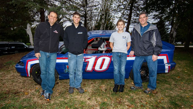 Car racing is a family activity for the Brauns and the Gebhards. Rob Braun (from left), his son RJ Bruan, Ricky Gebhard and his dad Pictured (from right) Rick Gebhard, his dad Richard Gebhard pose for a photo in front of a race car, Monday, Oct. 23, 2017.
