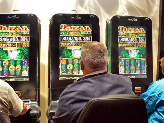 Customers play slots at The Casino at Ocean Downs in