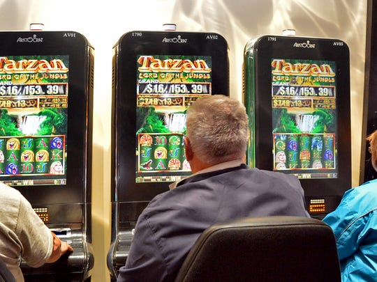 Customers play slots at The Casino at Ocean Downs in this file photo.