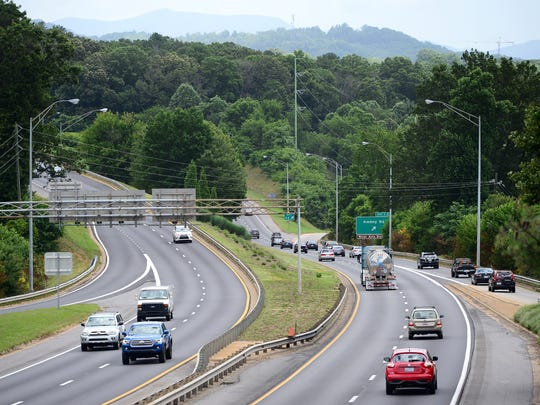 The Amboy Road exit is seen from the Brevard Road bridge over I-240 on Friday.  State government plans to rebuild the interchange as part of the I-26 Connector Project.