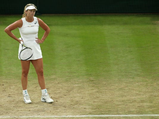 Coco Vandeweghe of the United States reacts after missing a point against Slovakia's Magdalena Rybarikova during their Women's Quarterfinal Singles Match on day eight at the Wimbledon Tennis Championships in London Tuesday, July 11, 2017. (AP Photo/Tim Ireland)