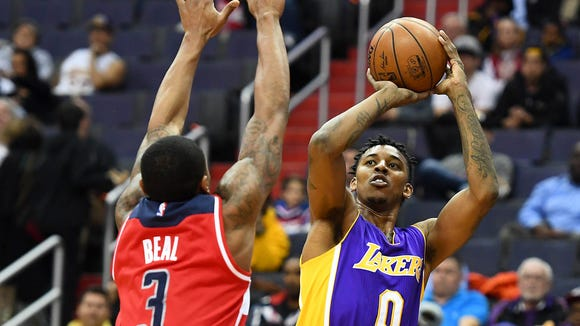 Los Angeles Lakers guard Nick Young (0) shoots over