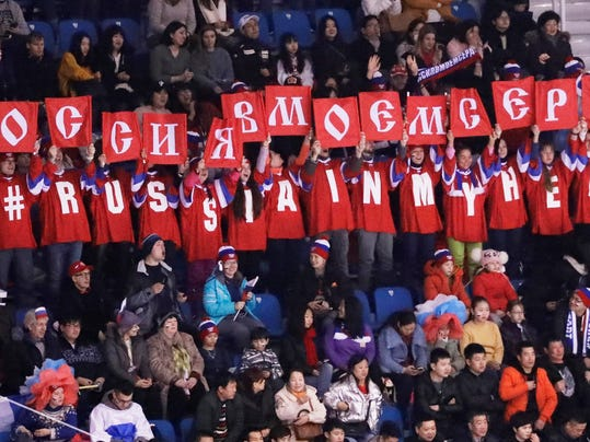 Supporters of Olympic Athlete for Russia Mikhail Kolyada hold up banners after his performance at the 2018 Winter Olympics in Gangneung, South Korea, Friday, Feb. 9, 2018. (AP Photo/Morry Gash)