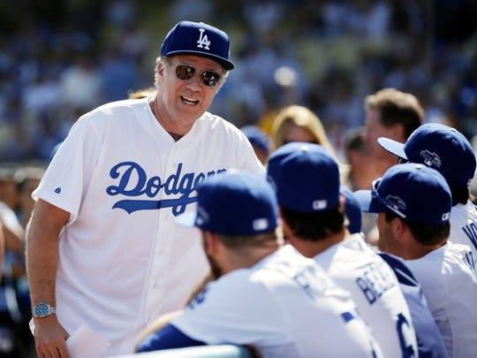 Ferrell chatted with the Los Angeles Dodgers before Game 5 of the National League baseball championship series against the St. Louis Cardinals.