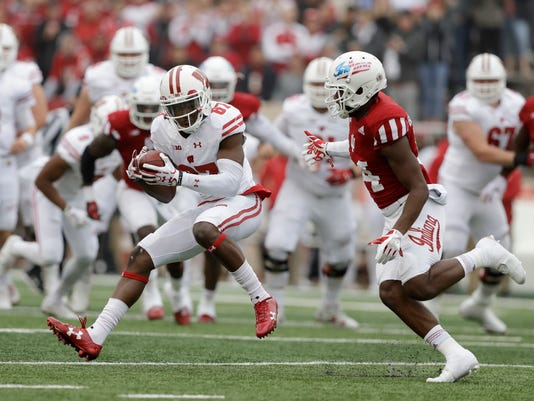 Wisconsin wide receiver Quintez Cephus (87) makes a catch against Indiana's Andre Brown Jr. (14) during the first half of an NCAA college football game, Nov. 4, 2017, in Bloomington, Ind. (AP Photo/Darron Cummings)