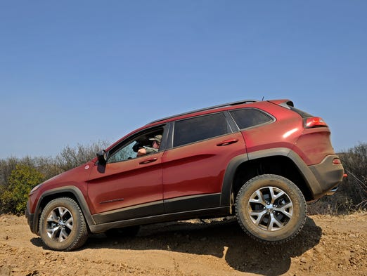 The new Jeep Cherokee lifts a wheel on a rutted road at a ranch in Thousand Oaks, Calif.