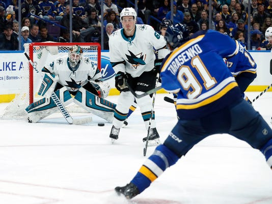 St. Louis Blues' Vladimir Tarasenko, right, of Russia, scores past San Jose Sharks' Justin Braun and goaltender Aaron Dell, left during the second period of an NHL hockey game Tuesday, March 27, 2018, in St. Louis. (AP Photo/Jeff Roberson)