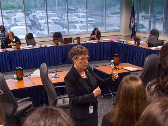 Jane R. Ingalls, R.N., Ph.D., President of the Virginia Board of Nursing, talks to medical students who were sitting in on disciplinary hearings for nurses from around the state on Sept. 18, 2014.