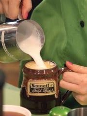 Jenavieve Verley, of Bennett's Fresh Roast, prepares